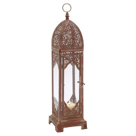 Add artful appeal to your living room etagere or entryway console table with this eye-catching candle lantern, showcasing an openwork iron design and a rust-...