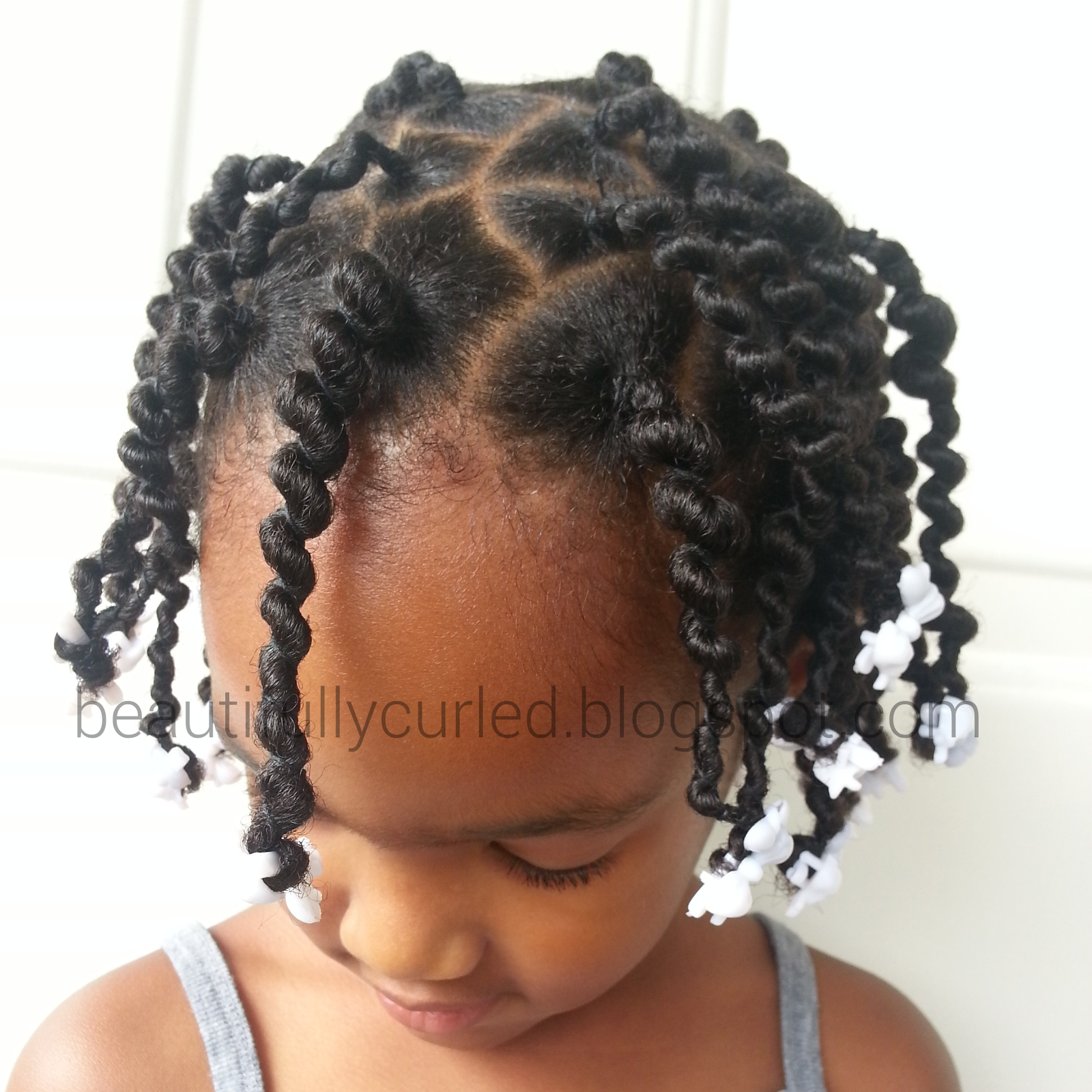 Beautifully Curled.......... First Attempt African Hair