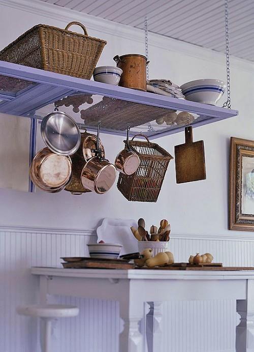 Repurpose an old door as a pot rack/ kitchen shelf