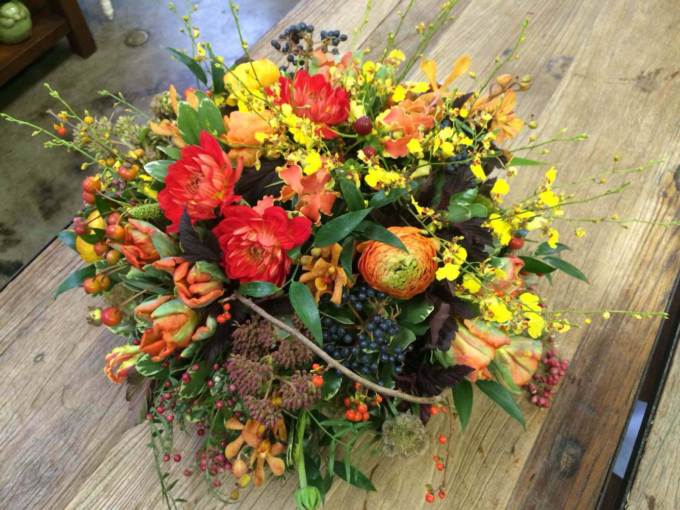 Gorgeous fall flower arrangement in sunset reds and yellows with