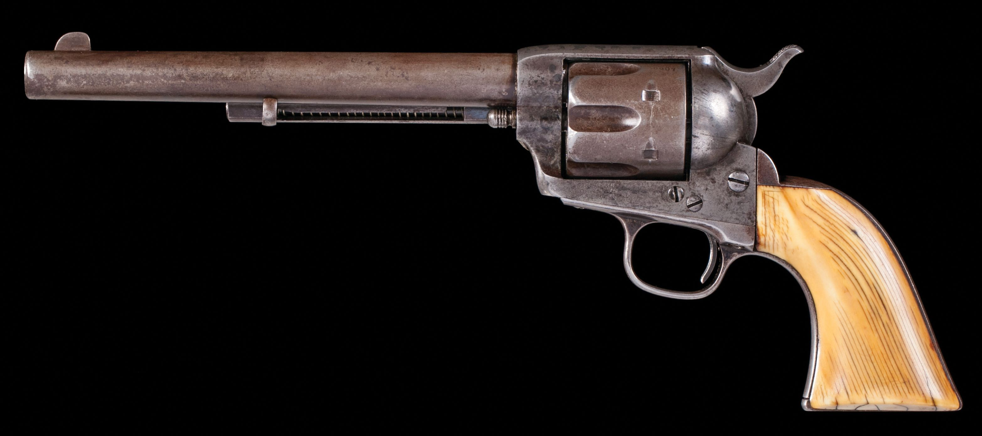 Colt Single Action Army .45 caliber, 7 ½ inch barrel, original blue and case color finish; one-piece grips, all matching numbers, circa 1883. Condition: Bore is very strong with minor pin prick oxidation, surface is smooth aged gun metal with touches of blue, grips were lightly checkered long ago and have worn down from use; the safety notch on the hammer is chipped otherwise excellent mechanically.