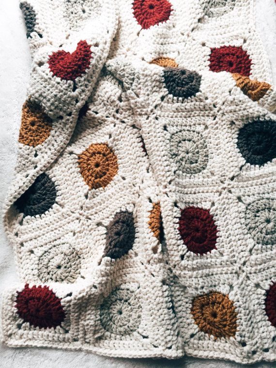 Introducing the Button Blanket, featuring those color pop granny squares you know and love! This cozy, chunky, granny square blanket is mostly cream colored, with pops of color of your choosing. Pick up to 2 unique colors for your color pops from the drop down menu. If you want more than 2 colors, please include them in the notes when you check out. If youd like to talk about creating a blanket with colors not listed here, OR of a different size, feel free to get in touch! Please be aware…
