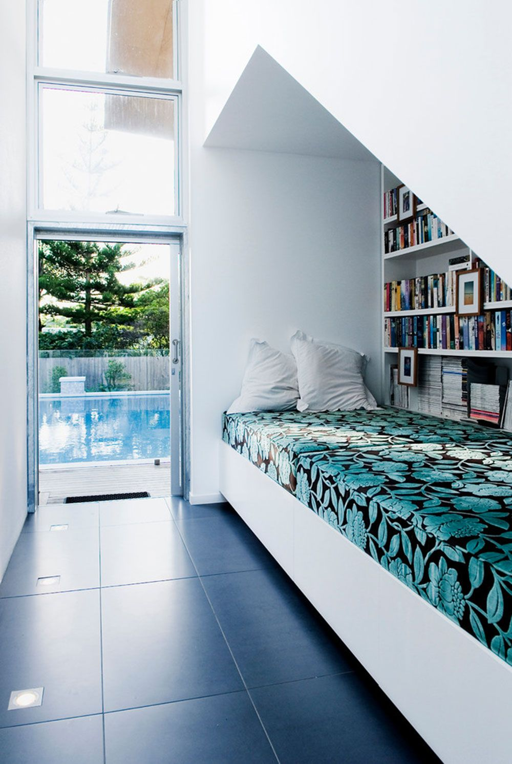 Bed under window  how to design a reading nook for poetic moments  nook designs