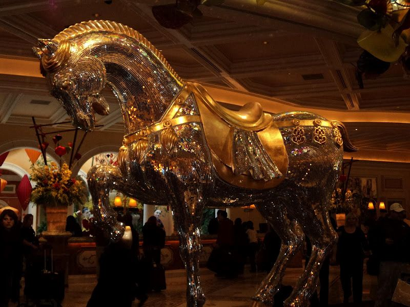 The Golden Horse In The Lobby Of The Bellagio In Front Of The Check In
