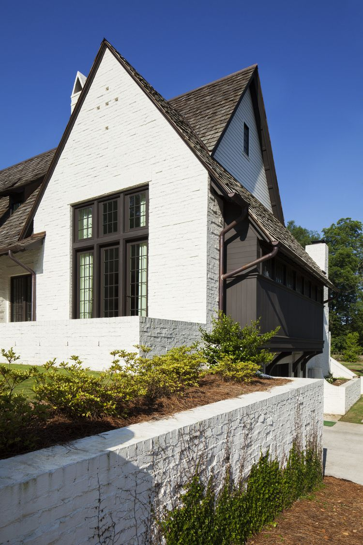 Architecture and interiors by krumdieck a i for Painted brick houses with siding