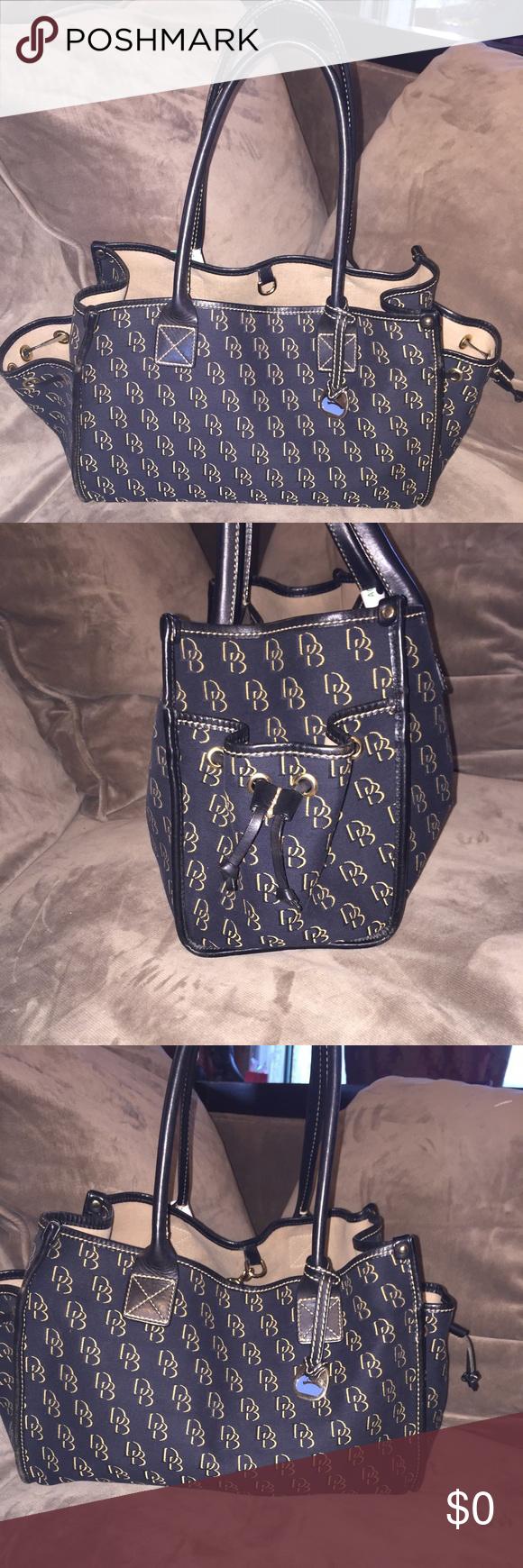 Dooney Bourke Black And Gold Logo Travel Bag Bags Satchels