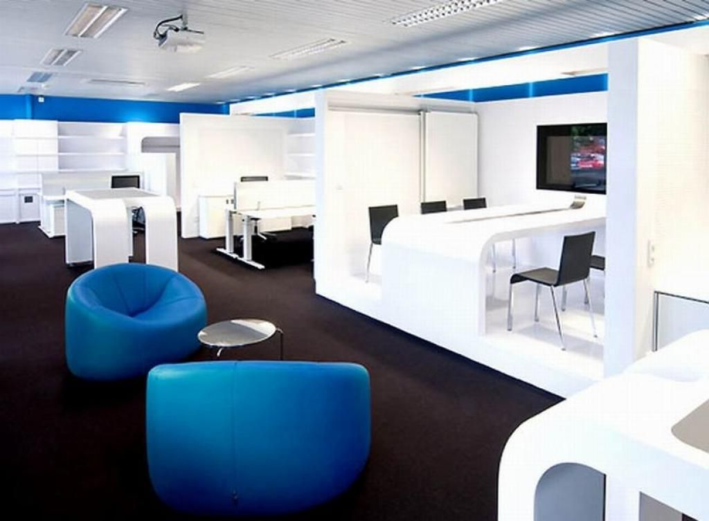 Modern Blue White Office Interior Furniture Set On Dark Laminate Flooring Style A Office Interior Design Modern Corporate Office Design Modern Office Interiors