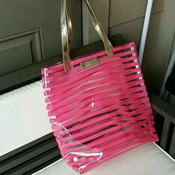 Victoria's Secret Clear Pink Stripe Tote Cute tote. Didn't use it much. Has a few smudges shown in pics but still in great condition. 11 1/2 by 13 Victoria's Secret Bags Totes