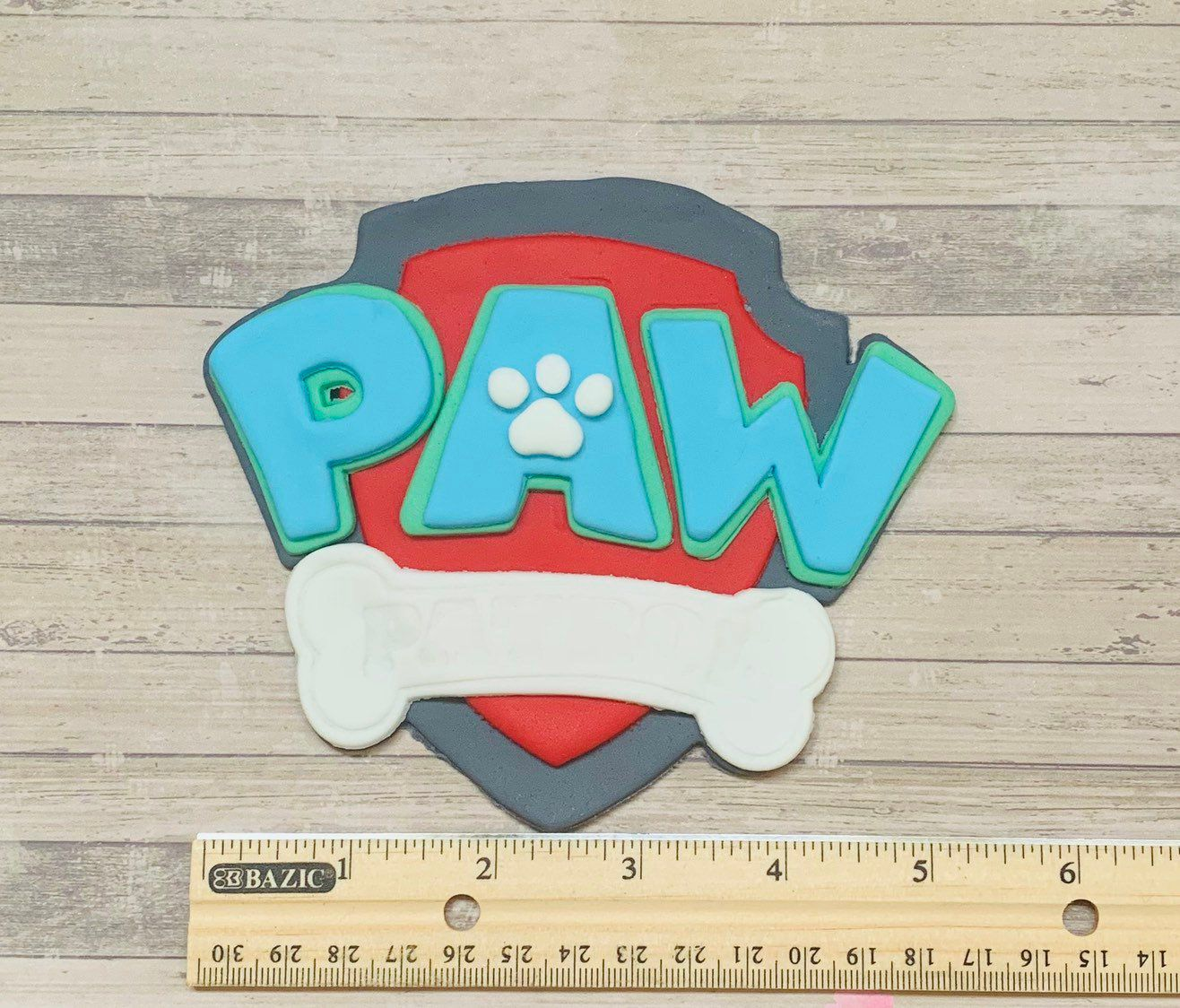 Paw Patrol Badge Fondant Cake Topper, Paw Patrol Cake Topper, Paw Patrol Fondant, Fondant Paw Patrol, Paw Patrol Topper, Paw Patrol, Party - Paw patrol cake toppers, Paw patrol cake, Paw patrol badge, Cake decorating company, Unique cakes designs, Fondant cake topper - Paw Patrol Badge Fondant Cake Topper Perfect to place on top of an ordinary frosted cupcake to make them look super glamorous and expensive!  I can make a custom assortment of your favorite comic book heroes not shown here, just convo me  Please allow 710 business days for processing as sugar edibles  must dry thoroughly before being ready to package and ship  Do not refrigerate or freeze (moisture buildup) and do not store in direct sunlight to prevent fading of the edibles