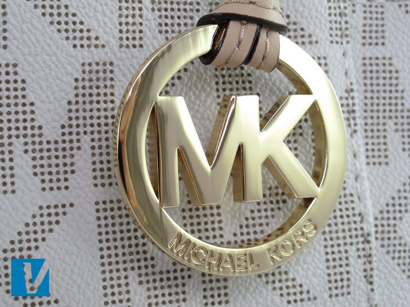 b7b75f5fd0b384 Most Michael Kors handbags feature a hanging MK logo. The distinct MK  letters are very close together and any engraving will be neat and clean.