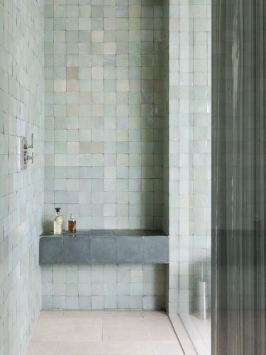 guest shower? glazed opening tiled seat and multi white wall