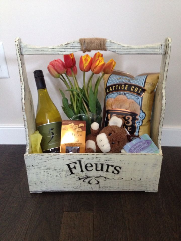 DIY - gift basket . Wine, chips,  chocolate , flowers and dog toy