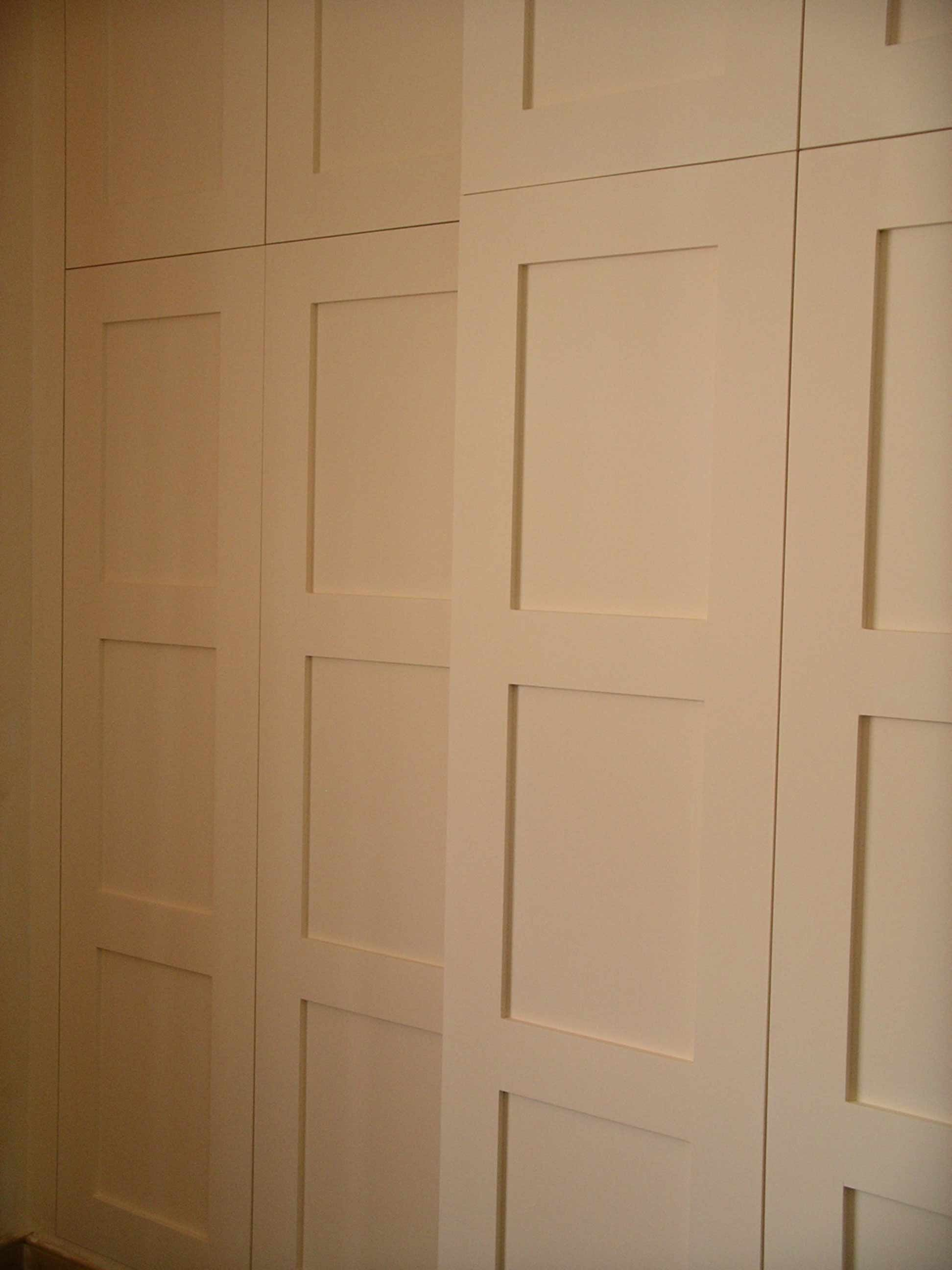 wardrobe hidden behind library panelling Paneling, Built