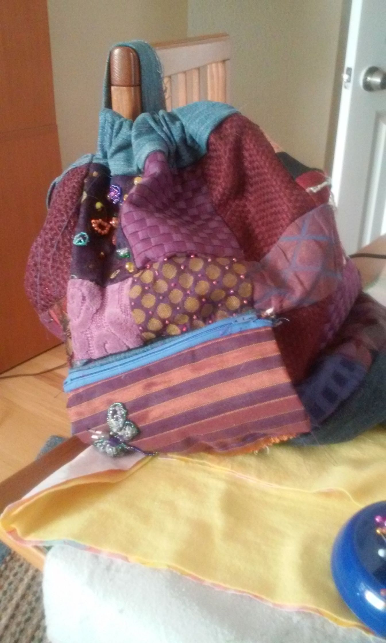 patchwork backpack for my girl. I have been making these for awhile now ,I had fun embellishing with beads this time.