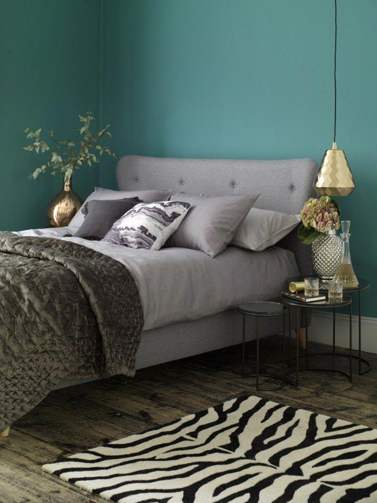 beautiful teal and grey bedroom interiors with splashes of