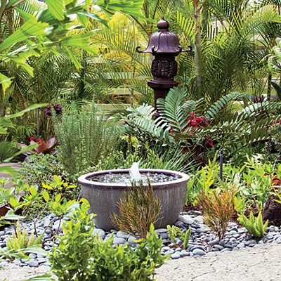 Tour a welcoming front yard deck fountain garden for Small garden feature ideas