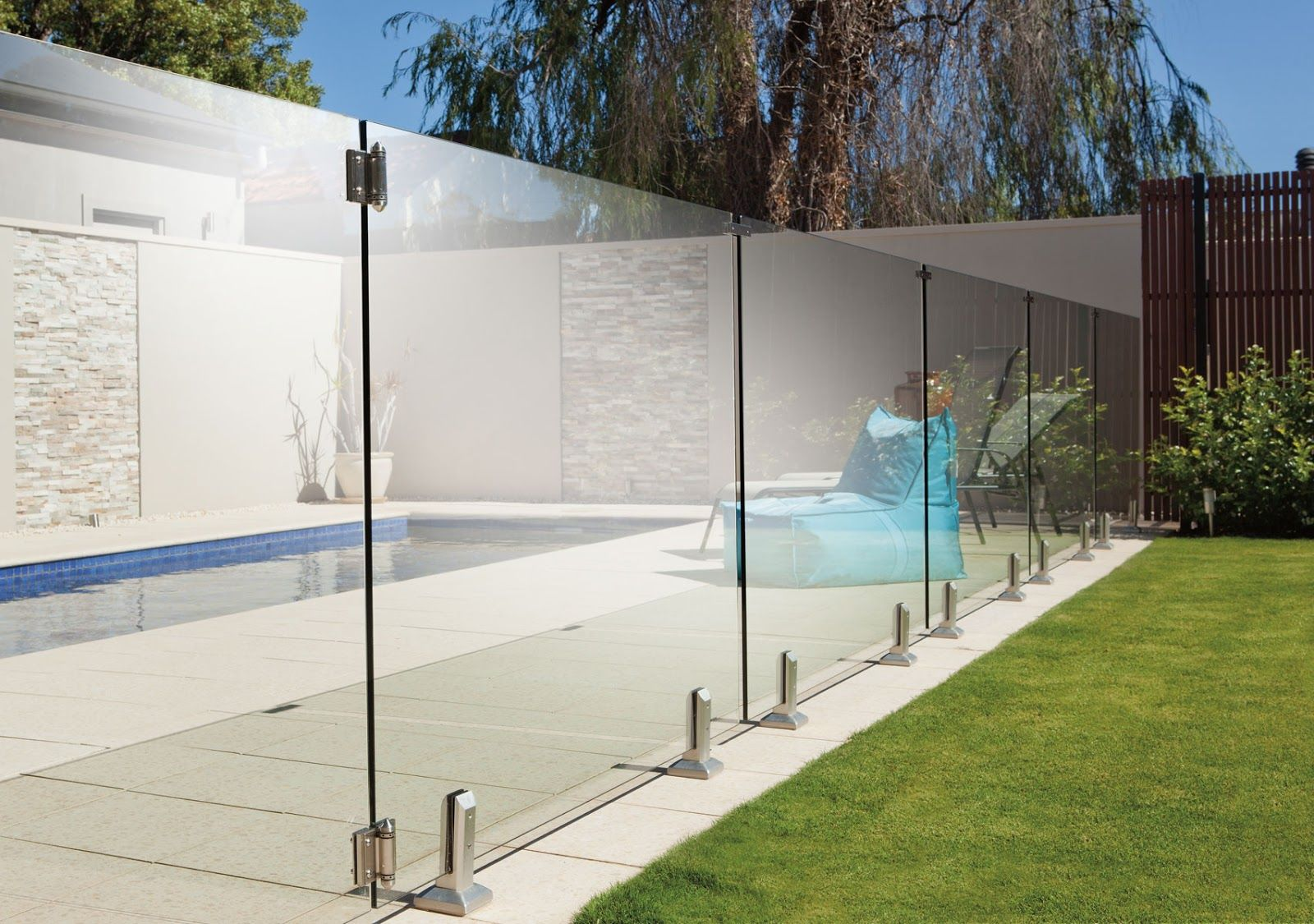 Why Pool Fencing In Wollongong Is Essential A Child S Attraction With The Swimming Pool Glass Fence Glass Pool Fencing Pool Fence