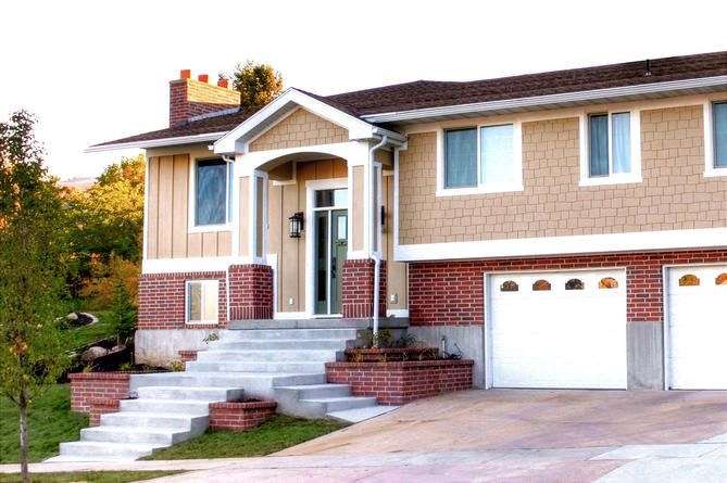 The Exterior Of This Split Level Home Was Updated By Adding A New Porch And