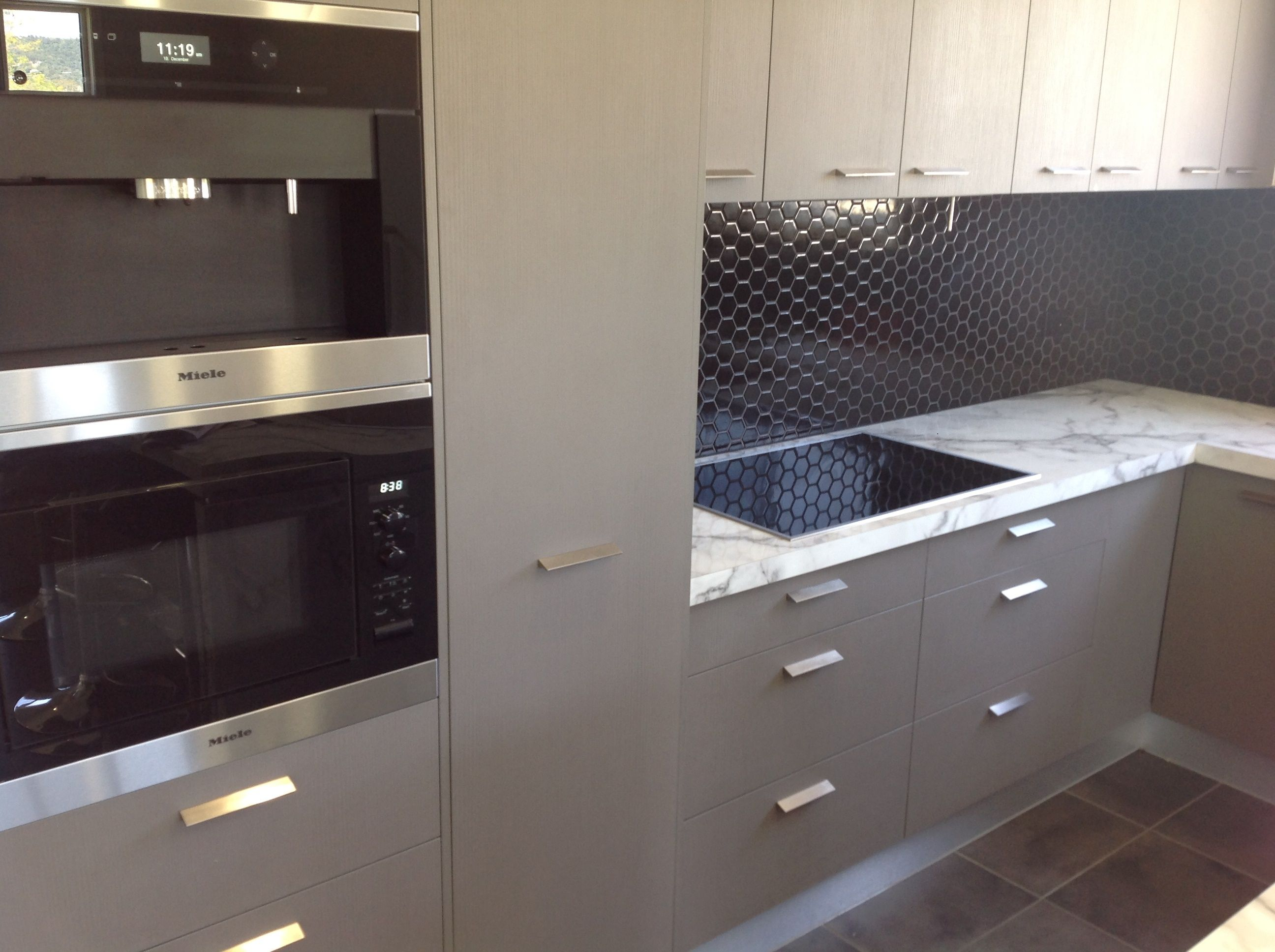 we selected miele appliances black and stainless steel coffee