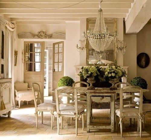 French Country interior...rustic with dramatic crystal chandelier <3