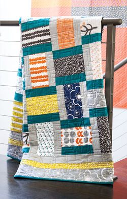 A beauty by Natalie!! strips and squares combine to make an easy block. weave the blocks together by placing every other one on its side, and your jelly basket appears. Fabric is Bella by Windham fabrics.
