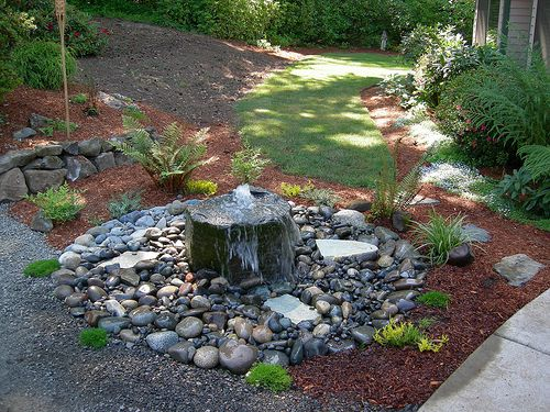 Small Bubbling rock water feature and plantings