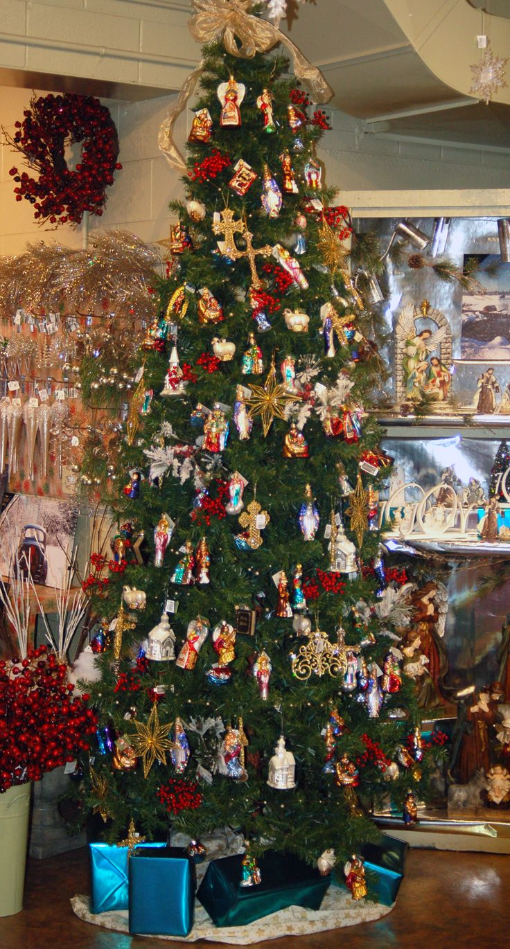 Elegant A Religious Theme Christmas Tree Filled With The Religious Collection Of  Old World Christmas Ornaments.