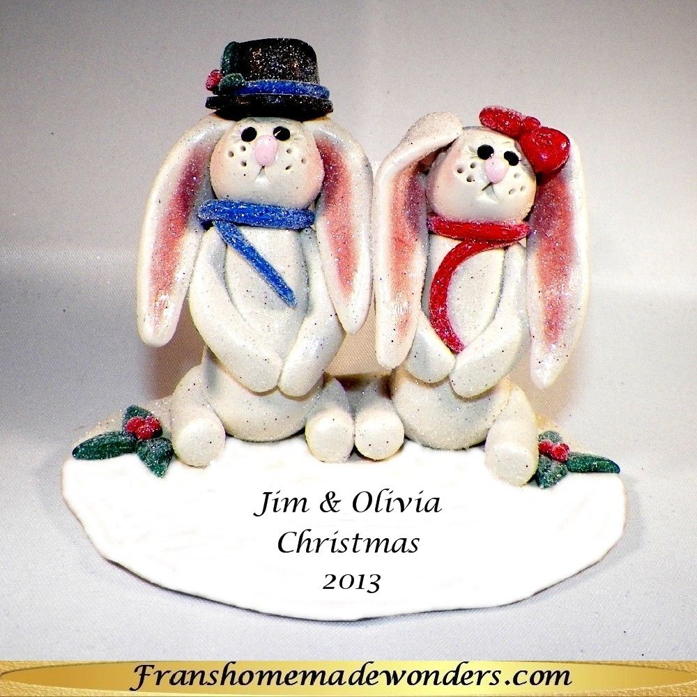 HANDMADE BUNNY COUPLE CHRISTMAS ORNAMENTS $20.00  These ornaments are entirely handmade of polymer clay. This couple has Swarovski crystal eyes and are on a snow drift.  He is wearing a scarf and his best top hat.  She is wearing a scarf and her cutest little bow.  They have an attached hanger and are approximately 2 ½ inches tall.  Personalization also available at NO additional charge. Order at www.franshomemadewonders.com