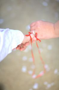 Red String of Fate:  An East Asian  belief originating from Chinese legend  and is also used in Japanese legend. According to this myth, the gods tie a red cord around the ankles of those that are to meet one another in a certain situation or help each other in a certain way. Often, in Japanese culture, it is thought to be tied around the little finger.   The two people connected by the red thread are destined lovers, regardless of time, place, or circumstances. This magical cord may stretch or