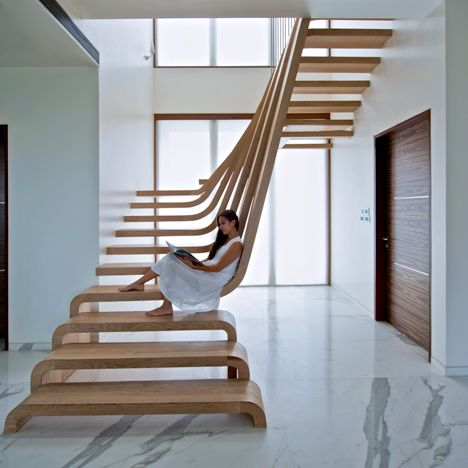 Mumbai House Waves Of Wood Form Staircase At SDM Apartment By Arquitectura  En Movimiento Workshop
