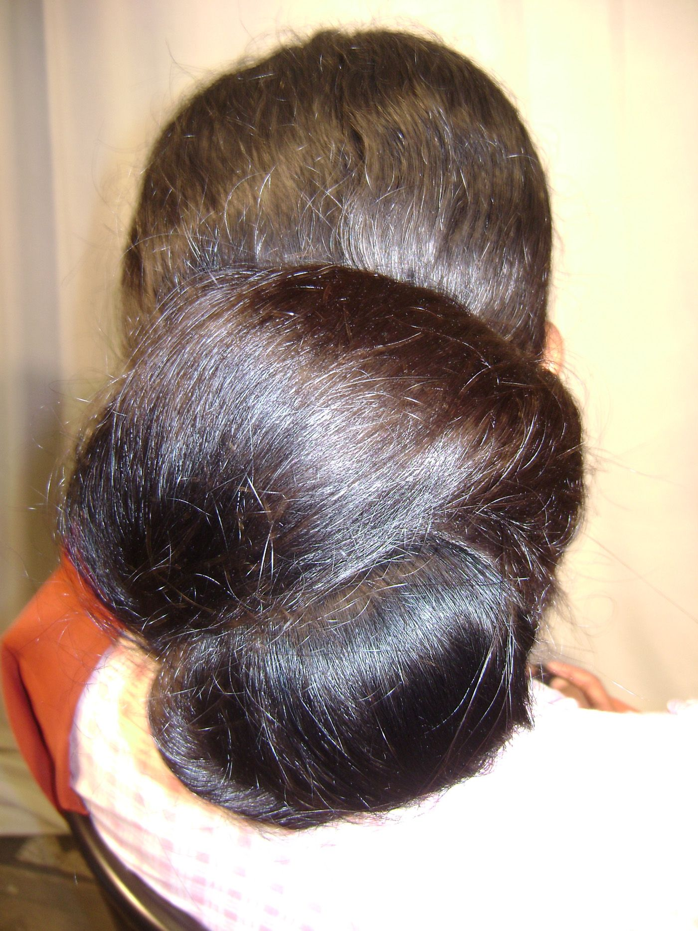 What a beautiful large low bun Care however should be taken before adopting such hairstyles as due to it s high static charge it will cause phlegm to