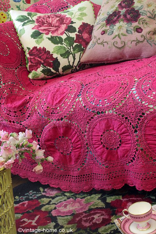 A Colourful Vintage Crochet With Cushions And A Hooked Rug
