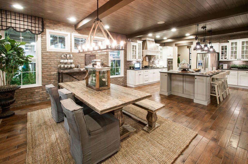 Rustic Kitchen With Wood Ceiling And Brick Accent Wall
