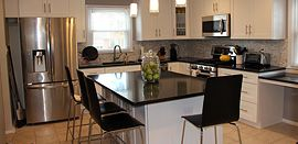 Love the kitchen island that serves as prep space as well as dining space