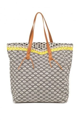 Everyone needs a beach bag and the mix of cowrie shells, leather straps with tassels and ikat print mean this Indi & Cold tote is the perfect addition to your Ibiza wardrobe  2 left £64.95