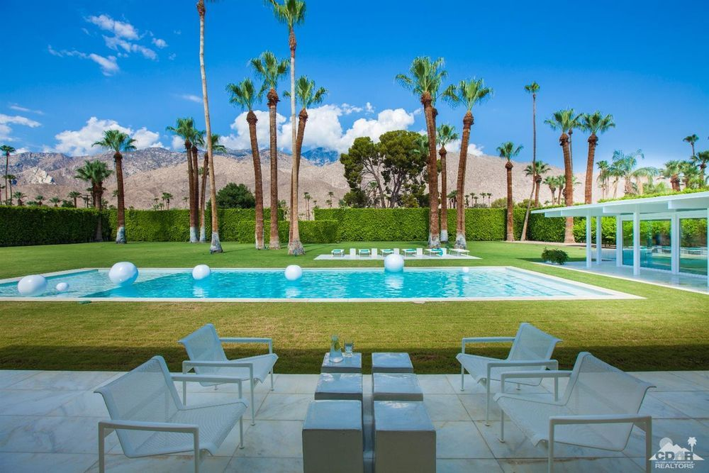 A MidCentury, White, Palm Springs Oasis Palm springs