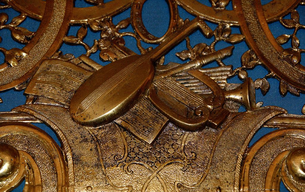 Birmingham museum and art gallery, musical clock. Made by Chas. Clay ~1735 ; ormolu case front attributed to John Michael Rysbrack ; painted decoration by Jacopo Amigoni.  The clock was altered in the 19th century to play then-popular ballads.