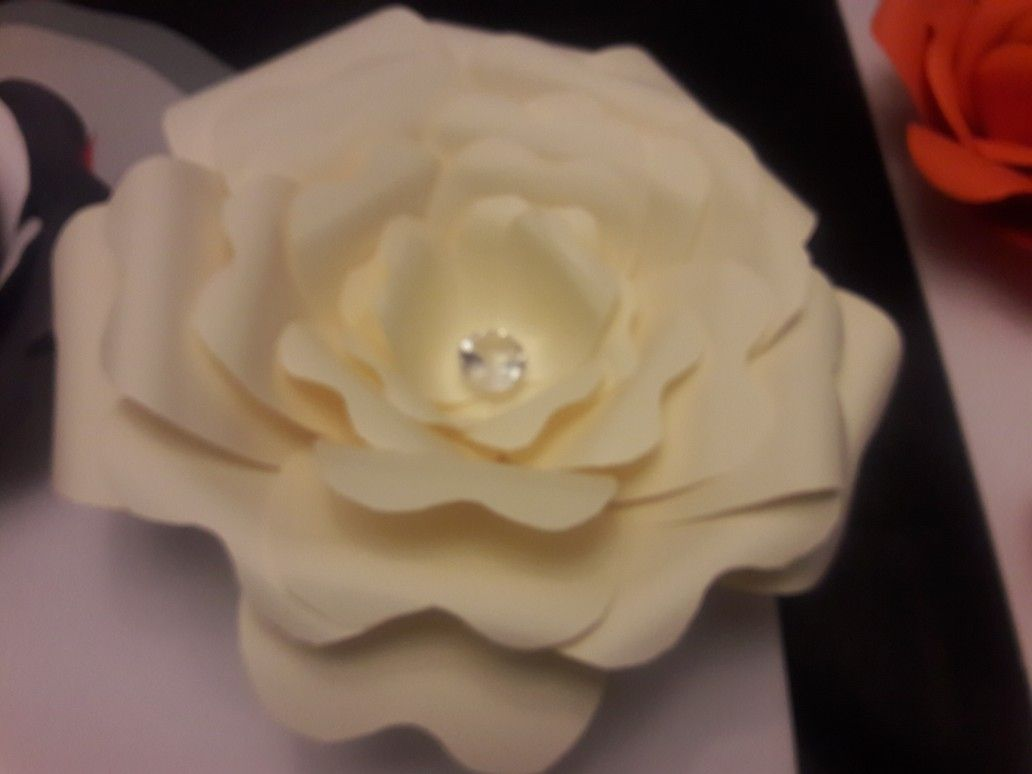 Big cream rose with a diamond center. Perfect for a glamed out space ...