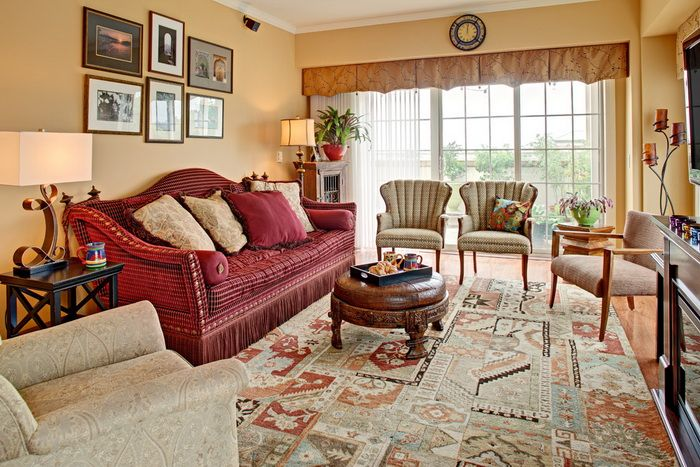warm living room design with vintage red maroon sofa round coffee table and colorful