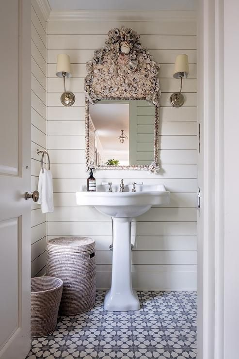 Shiplap pattern floor tiles and a pedestal sink will