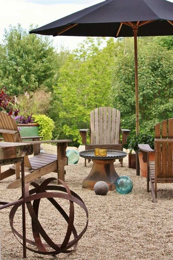 Patio Back Porch Used As A Relaxed Family With Tables Chairs And The Grill From Pea Gravel Materials