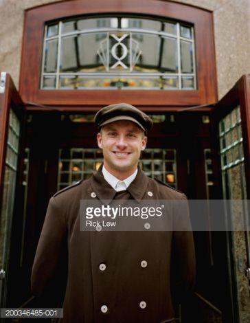Stock Photo  Hotel doorman standing outside doors portrait  sc 1 st  Pinterest & Hotel doorman standing outside doors portrait | Doors and Concierge