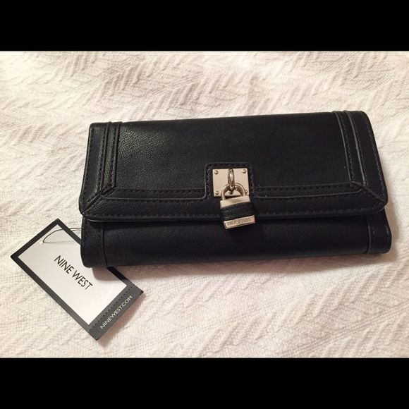 NWT Nine West Black Wallet NWT Nine West Tri-fold Wallet w Gold fashion buckle and snap closure. Metallic silver inside with plenty of storage. Zipper coin storage with pink lining on back. Great fashion staple for any bag! Nine West Bags Wallets