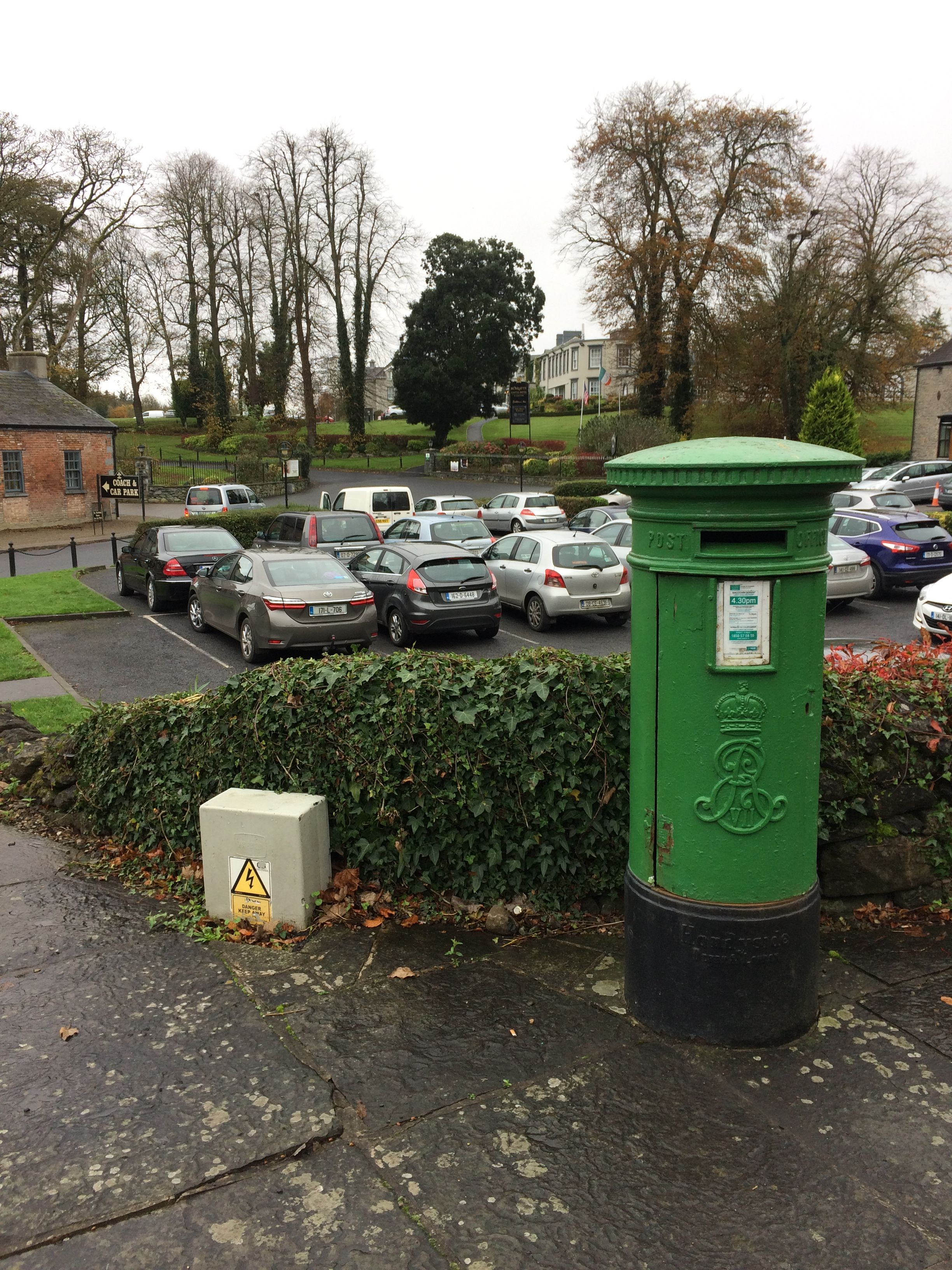 Irish post box from British rule times painted green since independence at Bunratty Co.Clare