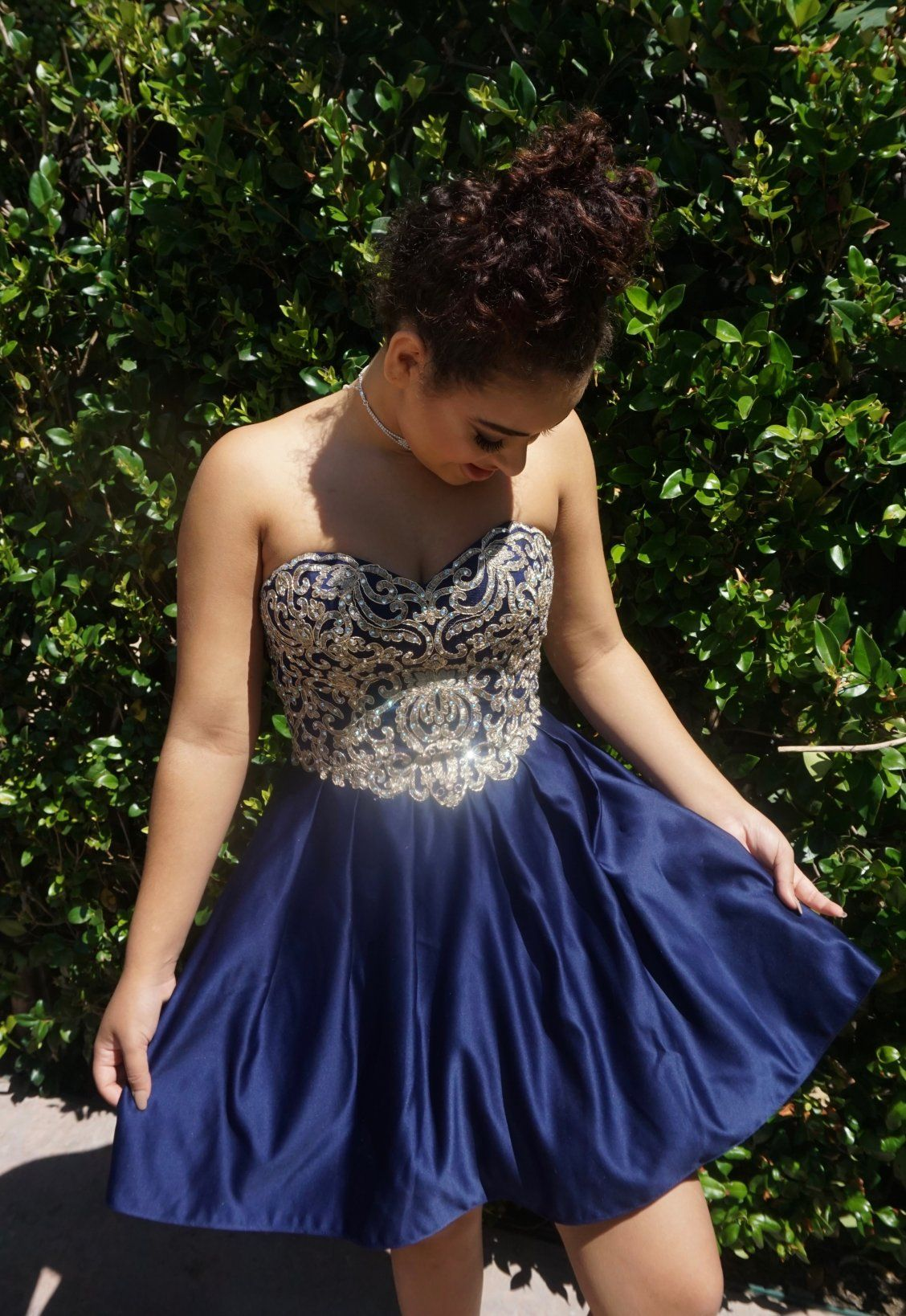 Devenity perkins in our short homecoming dress navy with gold
