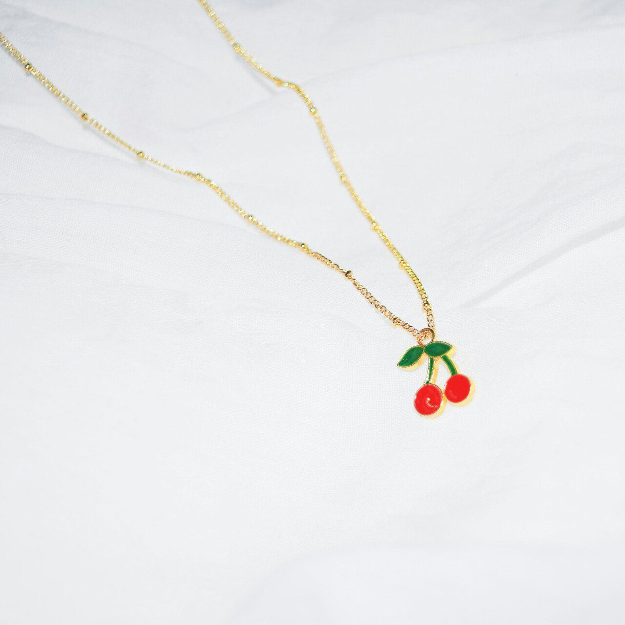 shop this trendy cherry gold necklace in our Depop shop!
