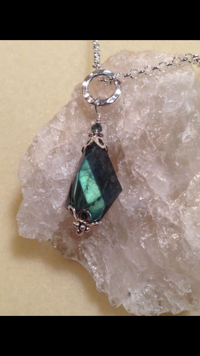Sterling silver necklace with labradorite stone. $50