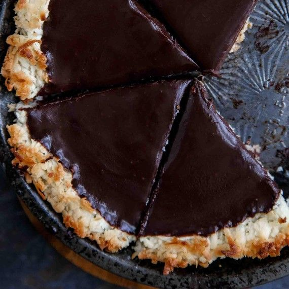 chocolate-coconut-tart 2 tablespoons unsalted butter, at room temperature -  7 ounces sweetened coconut flakes -  1/2 cup + 2 tablespoons heavy cream -  6 ounces semisweet chocolate chips
