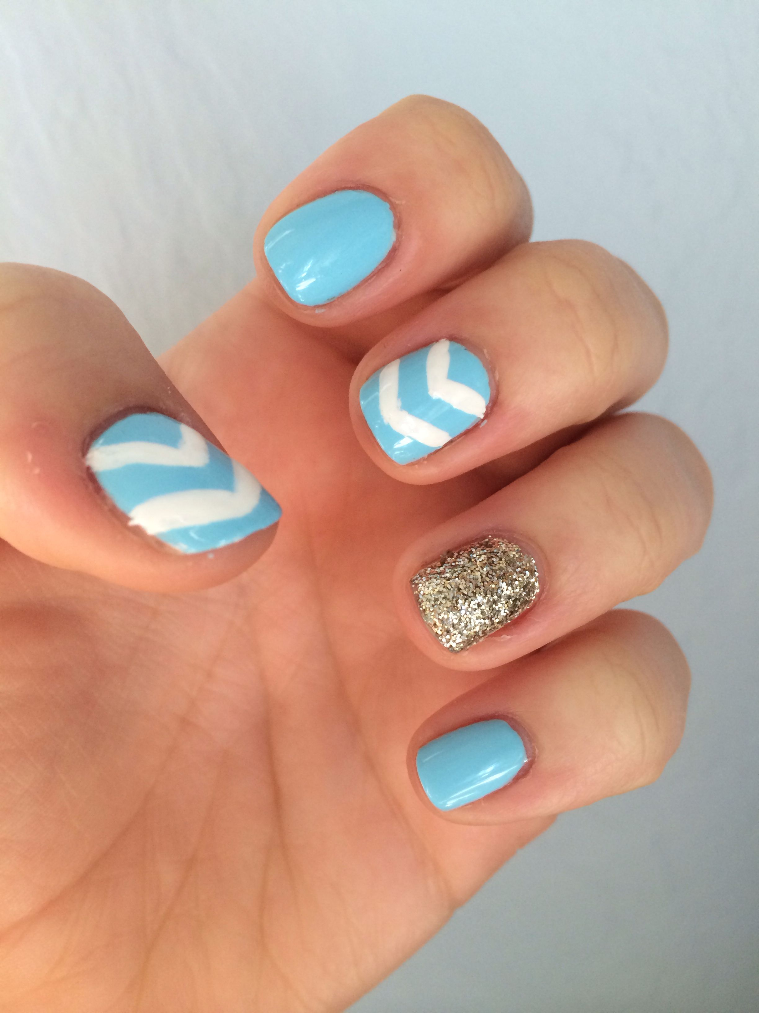 Baby blue with white chevron and gold accent nail for spring