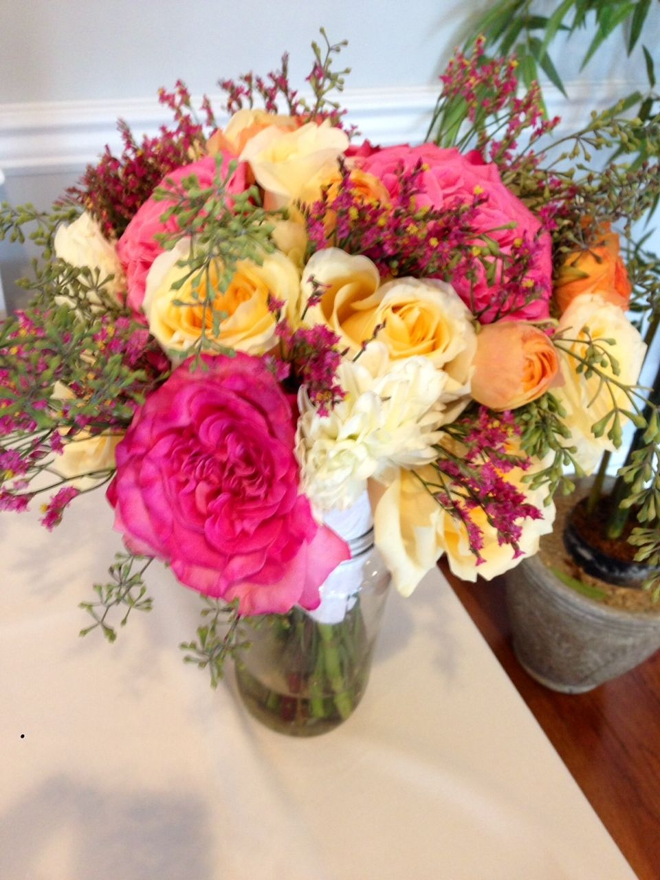 Eucalyptus seeds, garden roses, dahlia, and sweetheart roses.